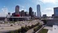 Stock Video Footage of Dallas Skyline aerial w/hwy traffic and Park