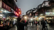 Stock Video Footage of The visitors roam and take photo at west street market in Yangshuo, China