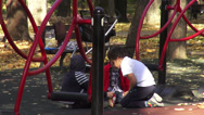 Stock Video Footage of Good fellows, happy kids sharing food on children's playground, fall season