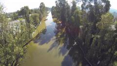 Flight over a water canal in Xochimilco - stock footage