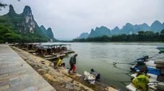 The local people do washing in Li river, Yangshuo, Guangxi, China Stock Footage