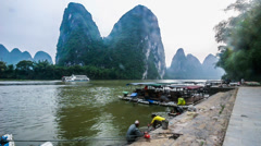 The local people do washing in Li river, Guilin, China Stock Footage