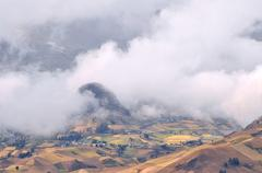 clouds on the fields of zumbahua in ecuadorian altiplano. highland andes near - stock photo