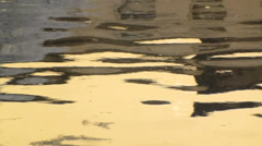 Soft gold lazy reflections in calm water Stock Footage