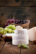 cheese variety.food background.  fresh ingredients on wood - stock photo
