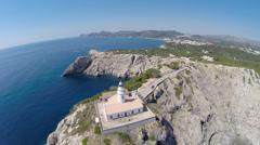 Flight over Cala Rajada´s Lighthouse on the Cliffs - Aerial Flight, Mallorca Stock Footage