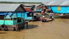 Floating village of Vietnamese refugees on Tonle Sap lake in Siem Reap, Cambodia Stock Footage