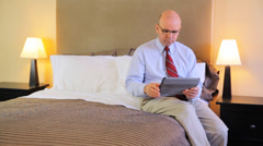 Mature Bald Business Man Using Computer Tablet In A Bedroom Stock Footage