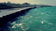 Waves Crash into Lakeshore, Slow Motion Footage Stock Footage