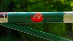 Barrier with stop sign. - stock footage