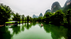 The bamboo raft with visitors goes on the Yulong river in Yangshuo - stock footage