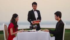 2of7 People eating at resort restaurant, boyfriend, girlfriend, couple, server Stock Footage