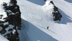Skier on the snow field in the mountains with the fall at high speed Stock Footage