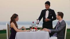 3of7 People eating in hotel restaurant, man, woman, couple, waiter Stock Footage