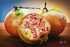 pomegranate and grains - stock photo