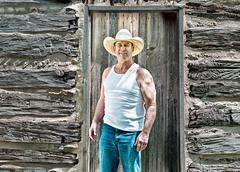 smiling cowboy saying howdy - stock photo