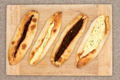four traditional turkish pide with meat and cheese - stock photo