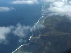 Viti levu coastline through clouds, UP11550 Stock Footage