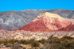 Colourful valley of quebrada de humahuaca, central andean altiplano, argentin Stock Photos
