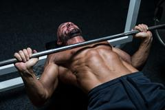 effort on the bench press - stock photo