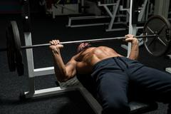 weightlifter on bench press - stock photo