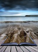 Book concept long exposure seascape landscape during dramatic evening in wint Stock Illustration