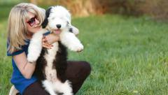 happy blonde with a puppy bobtail - stock footage