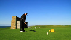 Golf Swing By Golfer - stock footage