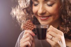 Stock Photo of attractive woman with coffee and cookies