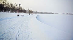 Footpath in snow at Onega lake quay Stock Footage
