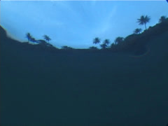 Ocean scenery exit to beach and tropical island on gloomy day, on islands, Stock Footage