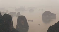 Morning mist Ha long Bay limestone karsts North Vietnam Asia Stock Footage