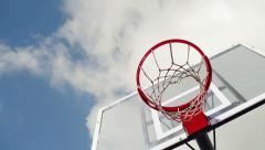 Basketball hoop with clouds time lapse footage in background. Stock Footage