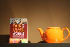 Fair trade sign and teapot - stock photo