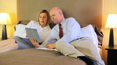 Mature Couple On A Bed Making A Phone Call Stock Footage