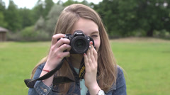 Blond girl photographer with photo camera shooting Stock Footage