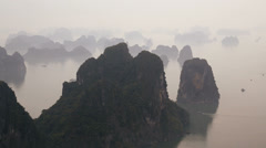 Ha long Bay mist limestone pillars Unesco region North Vietnam Stock Footage