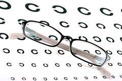 black glasses on a eye sight test chart - stock photo
