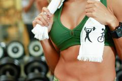 girl weight lifting, with bosom - stock photo