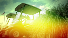 Sunburst Golf Carts | push in on golf carts with a vibrant color treatment Stock Footage