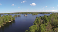 Spring Cottage Lake Aerial 08 Stock Footage