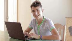 Teenager writing on his personal notebook - stock footage