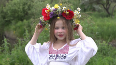 Little ukrainian girl with a wreath of flowers Stock Footage