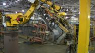 Stock Video Footage of Automated Robot Moves Car Part To Be Welded