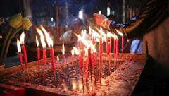 Many red candle in chinese temple Stock Footage