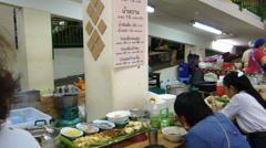 Dining and shopping at Warorot Market in Chiang Mai, Thailand Stock Footage