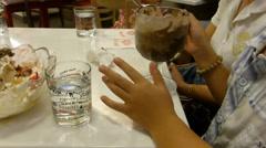 Enjoying vanilla and chocolate ice-cream together, Chiangmai, Thailand.(CM--2) Stock Footage