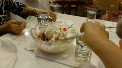Sharing and enjoying a big bowl of Thai ice-cream.(CM--1) Stock Footage