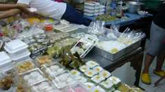 A snack stall at Warorot Market(also known as Kad Luang)Chiang Mai, Thailand Stock Footage