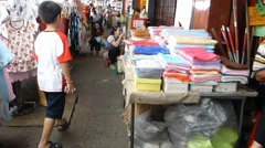 A boy navigating between stalls in narrow aisles of Chinatown Chiang Mai(CM-29b) Stock Footage